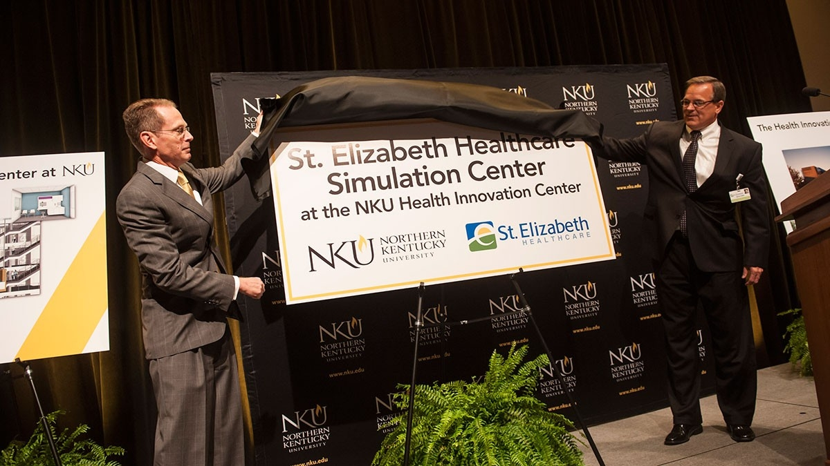 President Mearns dedicating St. E's healthcare stimulation center