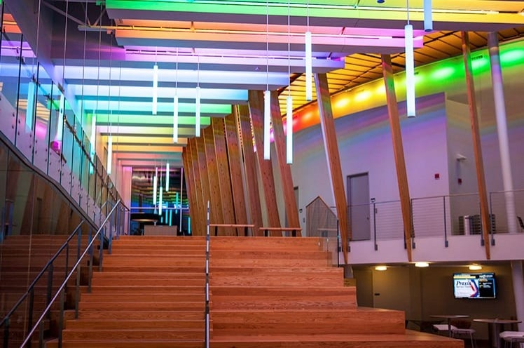 wooden stairs and rainbow lights