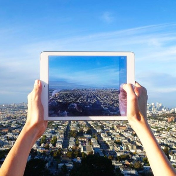Taking photography with an iPad of a cityscape.