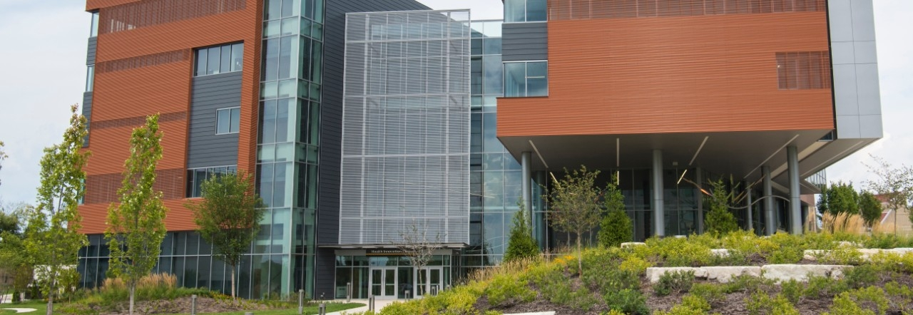 Facade of Health Innovation Center building with exterior landscaping.